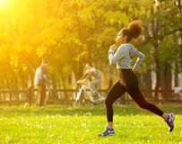 African american woman running outdoors Royalty Free Stock Photo