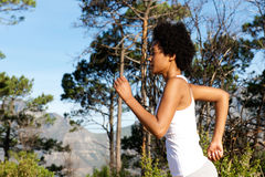 African american woman running outdoors Stock Images