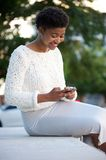 African american woman sending text message with cellphone Royalty Free Stock Photography