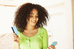 African american woman shoping with credit card Stock Images