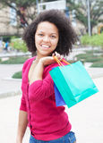 African american woman with shopping bags in the city Stock Photography