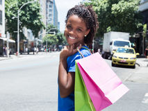 African american woman with shopping bags in the city Royalty Free Stock Images