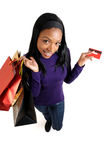 African american woman shopping with credit card. This is an image of a woman holding a shopping bag and credit card Royalty Free Stock Image
