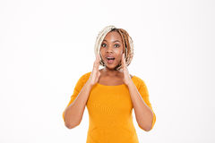 African american woman shouting and calling for somebody Stock Photos
