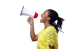 African American woman shouting at megaphone. Profile view of African American woman shouting at megaphone while standing against white background Stock Images