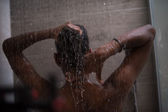 African American woman in the shower. Woman in the shower,beautiful black young female showering under refreshing water, healthy lifestyle, enjoying time in Stock Photography