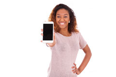 African American Woman showing a mobile phone. Isolated on white background Royalty Free Stock Image