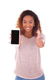 African American Woman showing a mobile phone and making thumbs Royalty Free Stock Images