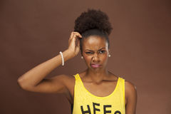 African American woman shows emotion with facial features. An African American woman shows emotion and confusion or irritation by her facial expression Royalty Free Stock Image