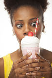 African American woman shows her milkshake Stock Images