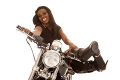 African American woman sit on motorcycle legs up looking royalty free stock photography