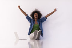 African american woman sitting on floor with laptop Royalty Free Stock Photography