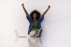 African american woman sitting on floor with laptop royalty free stock images