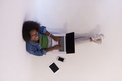 African american woman sitting on floor with laptop top view Stock Photo