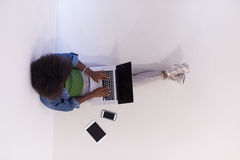African american woman sitting on floor with laptop top view Stock Photos