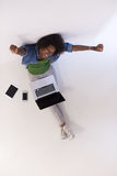 African american woman sitting on floor with laptop top view Stock Image