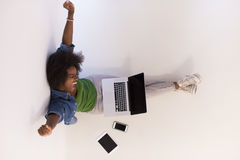 African american woman sitting on floor with laptop top view Stock Photography