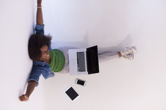 African american woman sitting on floor with laptop top view Royalty Free Stock Photos
