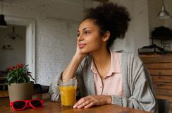 African american woman sitting at home thinking Royalty Free Stock Images