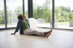 African american  woman  sitting near window Stock Photo