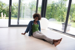 African american  woman  sitting near window Stock Photos