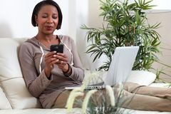 African-American woman with smartphone. Stock Photo