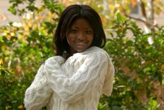 African-American woman smiling. Enjoying a sunny fall day stock image