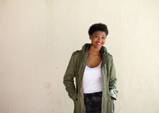 African american woman smiling with green jacket Stock Photography
