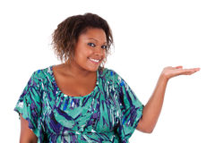 African American woman smiling holding something in her hand pal Stock Photo