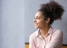 African american woman smiling and looking away Royalty Free Stock Photography