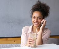 African american woman smiling with mobile phone Stock Image