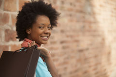 African american woman smiling with shopping bag Royalty Free Stock Images