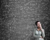 African American woman solving a difficult problem stock photo