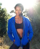 African american woman standing outdoors in blue sweatshirt Royalty Free Stock Photos