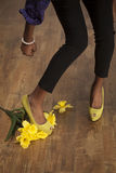 African American woman stomps fresh flowers. An African American woman gets mad and stomps on her fresh picked flowers stock photos