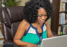 African American Woman Surfing the Web Stock Photography