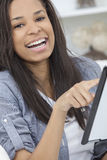 African American Woman on Tablet Computer At Home Royalty Free Stock Image