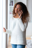 African American woman talking on a mobile phone - Black people Stock Photography