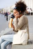 African american woman talking on mobile phone outdoors Stock Photo
