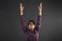 African American woman teacher or student reaching for the sky Stock Photo