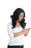 African American Woman texting on the phone. Pretty African American Woman texting on the phone Royalty Free Stock Photography