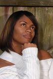 African-American woman thinking. While looking to the sky stock photos