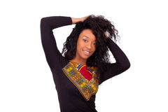 Free African American Woman Touching Her Curly Hairs Royalty Free Stock Photography - 68707377