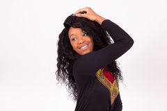 African American woman touching her curly hairs Royalty Free Stock Photography