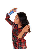 African American Woman Using Hair Spray. Stock Photography