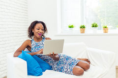 African american woman using laptop Royalty Free Stock Photos