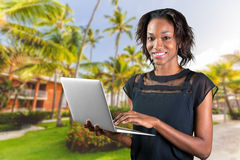 African american woman using laptop Stock Photos