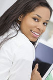 African American Woman Using Tablet Computer Stock Photo