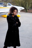 African American woman waiting at the airport Stock Photo