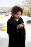 African American woman waiting at the airport Stock Image